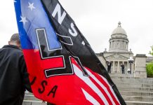 Flag with swastika and red, white and blue (© AP Images)