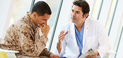Consulter talking with a Veteran