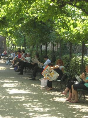 people reading on benches