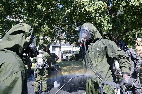 """Marines with Decontamination Platoon, Chemical Biological Incident Response Force, CBIRF, participate in a final training exercise with Fire Department of New York, FDNY, creating a force protection decontamination lane for Marines and sailors coming out of the """"hot zone"""" at Randall's Island, N.Y., Sept. 15, 2016. CBIRF's Marines and sailors participated in a training event that included three days of lane training with FDNY instructors teaching classes in vehicle extrication, breaching, rope rescue and medical as part of urban rescue operations, and a final training operation in which CBIRF responded to a notional steam plant explosion. (Official U.S. Marine Corps photo by Lance Cpl. Maverick S. Mejia/RELEASED)"""