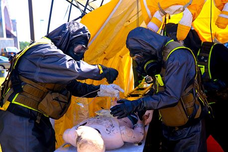 Marines with Decontamination Platoon, Chemical Biological Incident Response Force, CBIRF, participate in a final training exercise with Fire Department of New York, FDNY, decontaminating casualties that were extracted out of a steam plant at Randall's Island, N.Y., on Sept. 15, 2016. CBIRF's Marines and sailors participated in a training event that included three days of lane training with FDNY instructors teaching classes in vehicle extrication, breaching, rope rescue and medial as part of urban rescue operations, and a final training operation in which CBIRF responded to a notional steam plant explosion. (Official U.S. Marine Corps photo by Lance Cpl. Maverick S. Mejia/RELEASED)