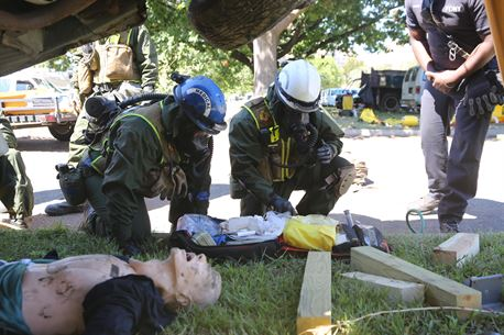 Corpsmen with Chemical Biological Incident Response Force, CBIRF, assess and attend to simulated casualties of a notional steam plant explosion as part of a final training exercise with Fire Department of New York, FDNY, on Randall's Island, N.Y., Sept. 15, 2016. CBIRF's Marines and sailors participated in a training event that included three days of lane training with FDNY instructors teaching classes in vehicle extrication, breaching, rope rescue and medical as part of urban rescue operations, and a final training operation in which CBIRF responded to a notional steam plant explosion. (Official U.S. Marine Corps photo by Lance Cpl. Maverick S. Mejia/RELEASED)