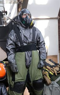 """Staff Sgt. Matthew Burke, an explosive ordnance disposal, EOD, technician with Chemical Biological Incident Response Force, CBIRF, puts on an EOD bomb suit while already in a level """"c"""" suit during a final training exercise with the Fire Department of New York, FDNY, on Randall's Island, N.Y., Sept. 15, 2016. CBIRF's Marines and sailors participated in a training event that included three days of lane training with FDNY instructors teaching classes in vehicle extrication, breaching, rope rescue and medical as part of urban rescue operations, and a final training operation in which CBIRF responded to a notional steam plant explosion. (Official U.S. Marine Corps photo by Lance Cpl. Maverick S. Mejia/RELEASED)"""