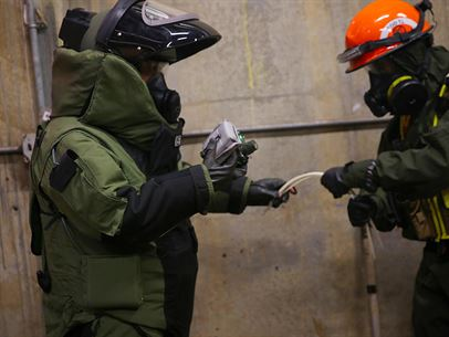Marines with Explosive Ordnance Disposal, EOD, platoon, Chemical Biological Incident Response Force, CBIRF, participate in a final training exercise with Fire Department of New York, FDNY, responding to and deactivating a notional explosive threat found at a steam plant on Randall's Island, N.Y., Sept. 15, 2016. CBIRF's Marines and sailors participated in a training event that included three days of lane training with FDNY instructors teaching classes in vehicle extrication, breaching, rope rescue and medical as part of urban rescue operations, and a final training operation in which CBIRF responded to a notional steam plant explosion. (Official U.S. Marine Corps photo by Lance Cpl. Maverick S. Mejia/RELEASED)