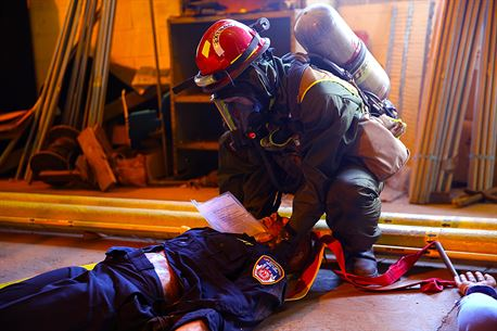 Marines with Search and Extraction Platoon, Chemical Biological Incident Response Force, CBIRF, extracted numerous casualties as part of a final training exercise with the Fire Department of New York, FDNY, on Randall's Island, N.Y., Sept. 15, 2016. CBIRF's Marines and sailors participated in a training event that included three days of lane training with FDNY instructors teaching classes in vehicle extrication, breaching, rope rescue and medical as part of urban rescue operations, and a final training operation in which CBIRF responded to a notional steam plant explosion. (Official U.S. Marine Corps photo by Lance Cpl. Maverick S. Mejia/RELEASED)