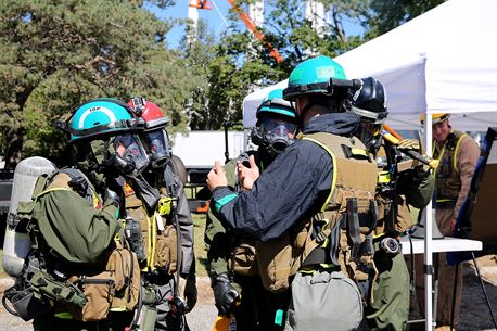 """Sgt. Augustin A. Romero, team leader for Identification and Detection Platoon, IDP, Chemical Biological Incident Response Force, CBIRF, talks to the Primary Assessment Teams before they head to the """"hot zone"""" to search and detect hazardous chemical agents during the training exercise with the Fire Department of New York, FDNY, on Randall's Island, N.Y., Sept. 15, 2016. CBIRF's Marines and sailors participated in a training event that included three days of lane training with FDNY instructors teaching classes in vehicle extrication, breaching, rope rescue and medical as part of urban rescue operations, and a final training operation in which CBIRF responded to a notional steam plant explosion. (Official U.S. Marine Corps photo by Lance Cpl. Maverick S. Mejia/RELEASED)"""