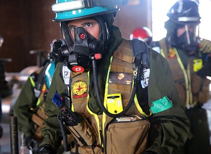 Cpl. Alex Sousa, team leader with Identification and Detection Platoon, IDP, is looking for casualties during their first primary assessment of a notional steam plant explosion during a training exercise with the Fire Department of New York, FDNY, on Randall's Island, N.Y., Sept. 15, 2016. CBIRF's Marines and sailors participated in a training event that included three days of lane training with FDNY instructors teaching classes in vehicle extrication, breaching, rope rescue and medical as part of urban rescue operations, and a final training operation in which CBIRF responded to a notional steam plant explosion. (Official U.S. Marine Corps photo by Lance Cpl. Maverick S. Mejia/RELEASED)