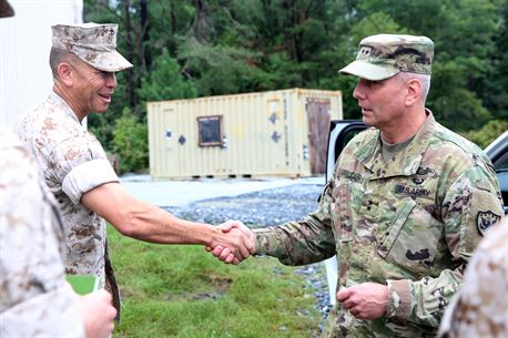 Army Maj. Gen. Richard Gallant, commander of Joint Task Force Civil Support, right, shakes hands with Marine Col. Michael Carter, commanding officer of Chemical Biological Incident Response Force (CBIRF), during an official visit at Naval Annex Stump Neck, Md., Sept. 29, 2016. Gallant visited CBIRF's own training site the Downey Responder Training Facility to learn more about the Marines and sailors with CBIRF, their training capabilities,  and the equipment they use for chemical, biological, radiological, nuclear and high-yield explosive (CBRNE) crisis response and consequence management. (Official U.S. Marine Corps photo by Sgt. Jonathan Herrera/Released)