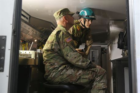 Marine Cpl. Devon Woycke, a team member with Identification and Detection Platoon, Chemical Biological Incident Response Force (CBIRF), shows Army Maj. Gen. Richard Gallant, commander of Joint Task Force Civil Support, the mobile laboratory mechanisms used to identify chemical and biological agents during an official visit at Naval Annex Stump Neck, Md., Sept. 29, 2016. Gallant visited CBIRF's own training site the Downey Responder Training Facility to learn more about the Marines and sailors with CBIRF, their training and operational capabilities,  and the equipment they use for chemical, biological, radiological, nuclear and high-yield explosive (CBRNE) crisis response and consequence management. (Official U.S. Marine Corps photo by Sgt. Jonathan Herrera/Released)