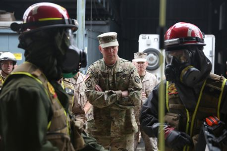 Army Maj. Gen. Richard Gallant, commander of Joint Task Force Civil Support, center, watches as Marines with Search and Extraction Platoon, Chemical Biological Incident Response Force (CBIRF), enter a simulated contaminated building to search for casualties during an official visit at Naval Annex Stump Neck, Md., Sept. 29, 2016. Gallant visited CBIRF's own training site to learn more about the Marines and sailors with CBIRF, their training and operational capabilities,  and the equipment they use for chemical, biological, radiological, nuclear and high-yield explosive (CBRNE) crisis response and consequence management. (Official U.S. Marine Corps photo by Sgt. Jonathan Herrera/Released)