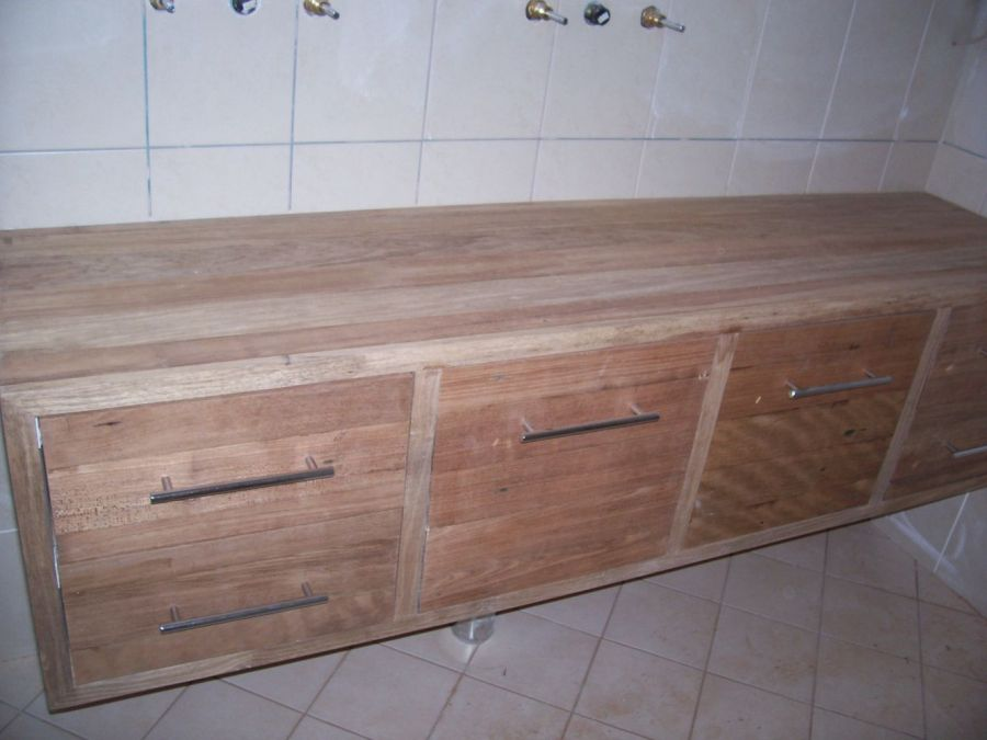 A Solid timber vanity made from old floor boards by Damian's Handyman Services.