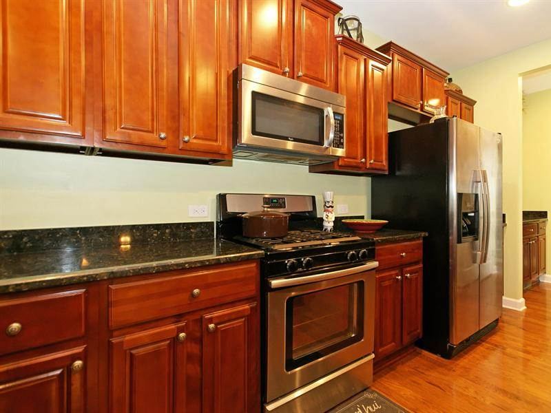 Image of: How to Clean Cherry Kitchen Cabinets