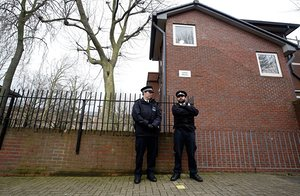 Police outside flats in west London believed to be where Mohammed Emwazi used to live.