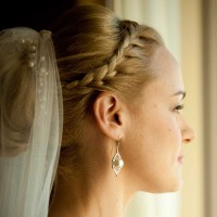 classical low bun hairstyle with veil and bids 2015