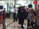 The woman slaps a female mall security official. Screen grab obtained from an Express Tribune video