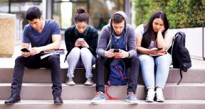 young adults on smartphones