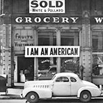A store owner's response to anti-Japanese sentiment in the wake of the Pearl Harbor attack, Oakland, Calif., 1942.
