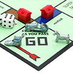 English Edition of Monopoly showing Pass Go, The classic trading game from Parker Brothers was first introduced to America in 1935.