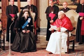 E2 with Pope John Paul II in traditional dress, since abandoned in favor of regular wear.