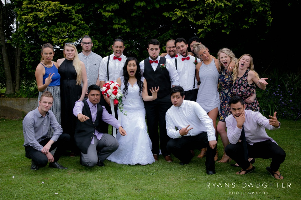 Funny group photo of a bridal party, guests with the bride and groom at Rosenvale wedding venue, Waikato
