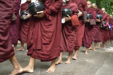 Monks and novices in a row - Sami Sarkis/Photographer's Choice/Getty Images
