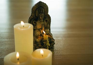 Guanyin With Candles - © ZenShui / Sigrid Olsson / Getty Images