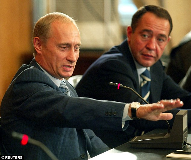 Key aide: Mikhail Lesin (right, with Putin), who was Putin's press secretary during his first stint as president, founded state television network Russia Today, regarded in the West as a mouthpiece for the Kremlin