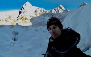 Ryan Sean Davy hid in a cave while climbing Mount Everest to dodge paying fee.