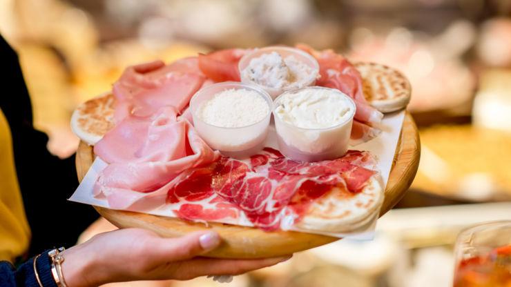 Platter of mortadella and cold cuts, Bologna, Italy.