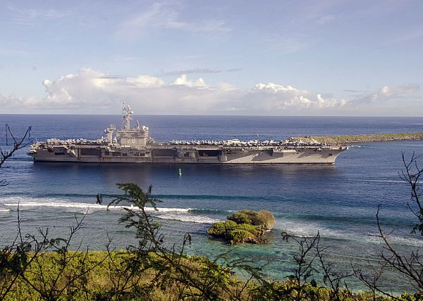 The Nimitz-class aircraft carrier USS Carl Vinson (CVN 70) pulls into Naval Base Guam. Vinson is on a western Pacific deployment with the its carrier strike group as part of the U.S. Pacific Fleet-led initiative to extend the command and control functions of the U.S. 3rd Fleet in the Indo-Asia-Pacific region.  U.S. Navy photo by Mass Communication Specialist 2nd Class Allen Michael McNair (Released)  170210-N-YM720-028
