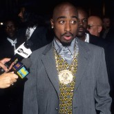 Forever 21 And Urban Outfitters Sued For Unauthorized Tupac Photos