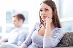 woman bored with man's conversation