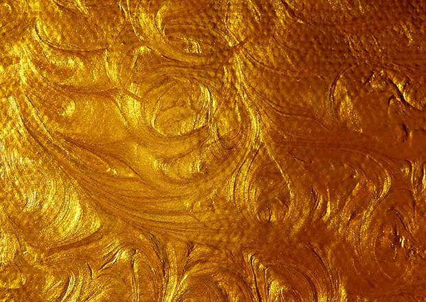acrylic-gold-paint-swirl-stock