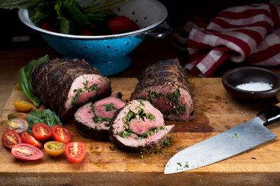 A beef tenderloin roast with zesty, garlicky pesto swirled inside is a good choice for an elegant outdoor dinner.