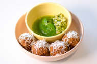 At Kismet in Los Angeles, aromatic freekeh fritters are deep fried and come with a pickle-y green sauce.