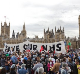 1318224264-national-health-service-reform-protesters-block-westminster-bridge_866483