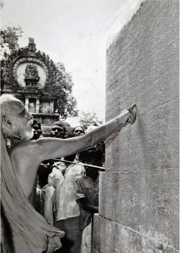 Kanchi Mahaswamigal reading an inscription on a temple wall