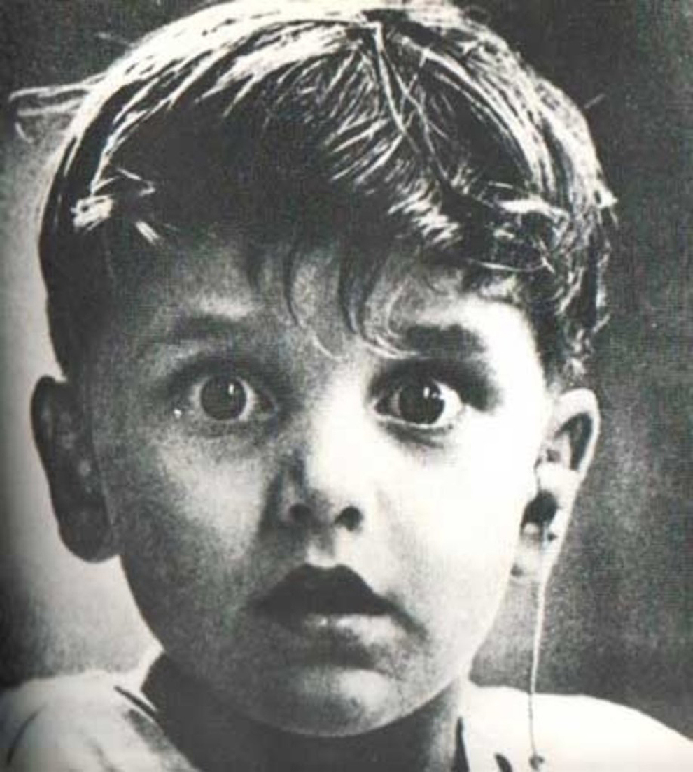 Harold Whittles hears for the first time ever after a doctor places an earpiece in his left ear
