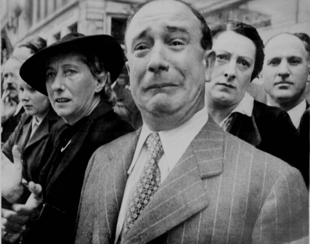 A French civilian cries in despair as Nazis occupy Paris during World War II