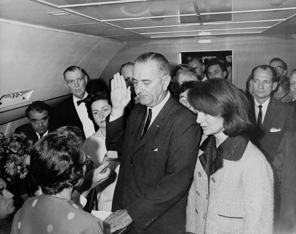 Jackie-kennedy-wears-pink-Chanel-suit-with-blood-of-her-husband-aslyndon-johnson-is-sworn-into-office