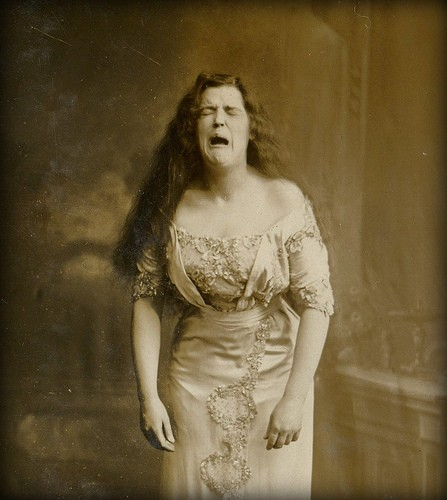 portrait-of-woman-in-mid-sneeze