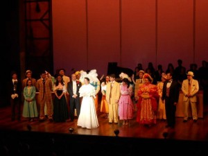 "Christine Toy Johnson, in white, as ""Dolly"" with the cast at the Curtain Call. What a fabulous ensemble cast!"