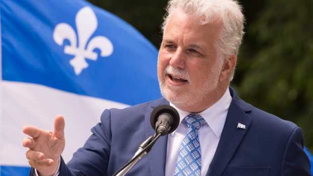 Quebec Premier Philippe Couillard speaks at a ceremony marking the Fête  Nationale on Thursday.