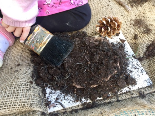 Clay, compost and a brush