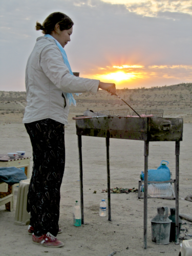 Watching my wife fry up some breakfast for me in a Turkmen desert - my idea of heaven