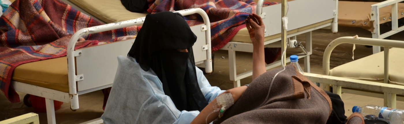 MSF nurse checks a patient's blood pressure while responding to the cholera outbreak in Yemen in May 2017.