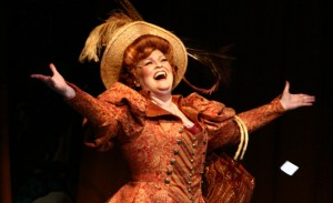 Monica M. Wemitt as Dolly Levi. (Photo Credit: The Mac-HaydnTheatre, Chatham, NY.)