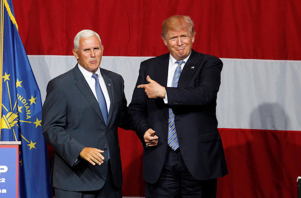 Republican U.S. presidential candidate Donald Trump points to Indiana Governor Mike Pence before addressing the crowd during a campaign stop at the Grand Park Events Center in Westfield