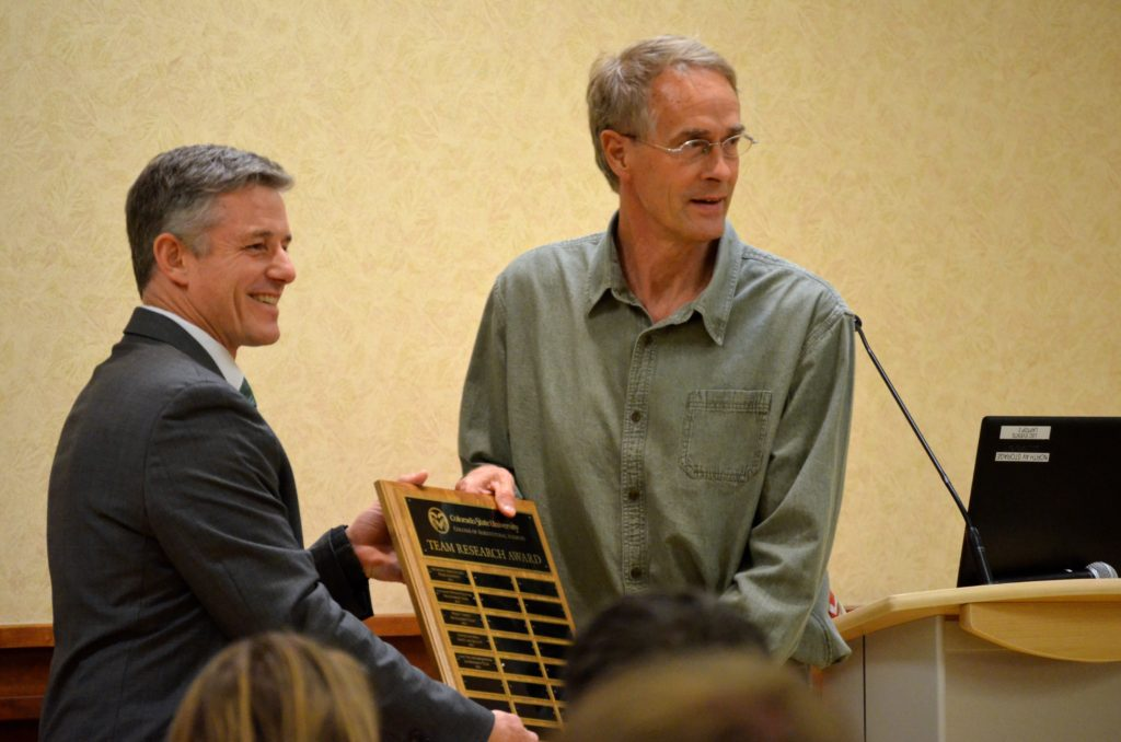 keith paustian accepts team research award