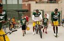 Cruising to Packers practice on bikes